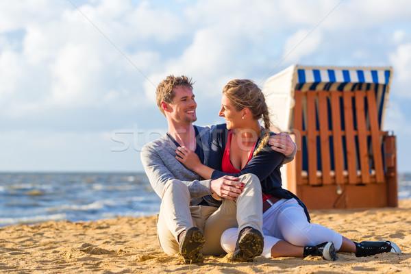 Couple in romantic sunset on beach Stock photo © Kzenon
