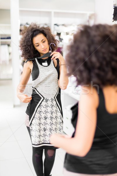 Latina Woman shopping fashion dress in store Stock photo © Kzenon