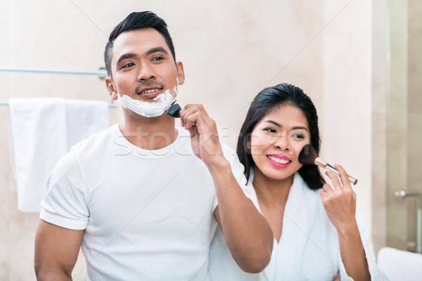 Asian morning couple in bathroom Stock photo © Kzenon