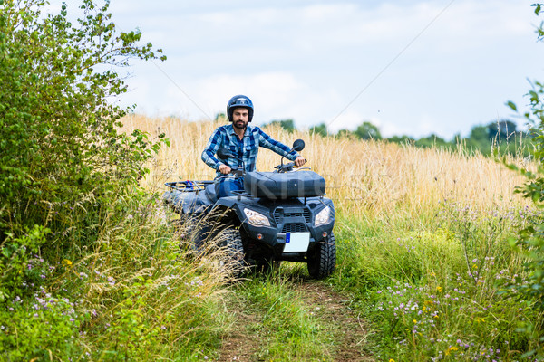 Man driving off-road with quad bike or ATV Stock photo © Kzenon