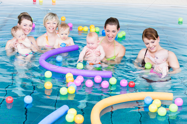 Moms and babies playing at infant swimming class  Stock photo © Kzenon