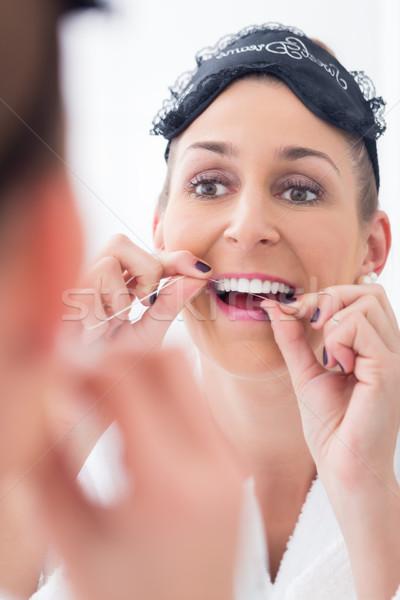 Kadın temizlik dişler diş ipi göz Stok fotoğraf © Kzenon