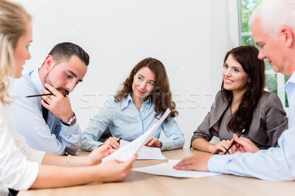 Lawyers having team meeting in law firm Stock photo © Kzenon