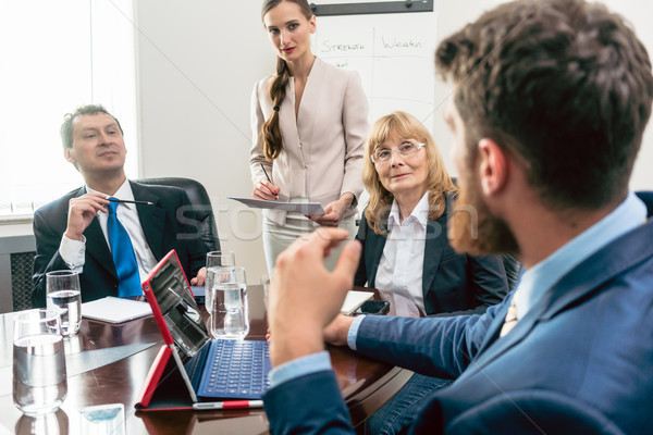 Happy middle-aged managers listening to their younger colleague  Stock photo © Kzenon