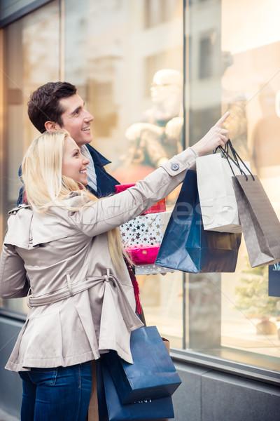 Couple at shop window doing Christmas shopping Stock photo © Kzenon