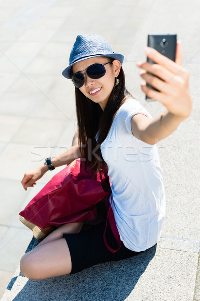 Young Asian woman making selfie pictures Stock photo © Kzenon