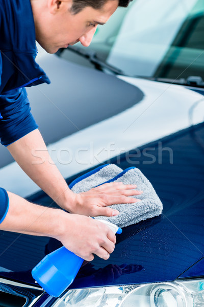 Hands cleaning car with spray cleaner and microfiber towel Stock photo © Kzenon
