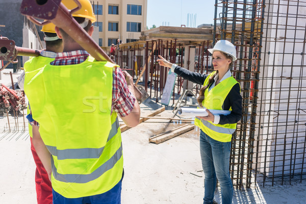 Experienced female foreman coordinating and guiding workers Stock photo © Kzenon