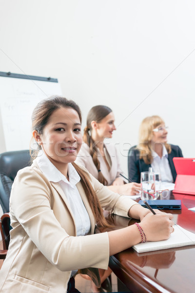 Portrait of a confident Asian business woman during a decision-making meeting Stock photo © Kzenon