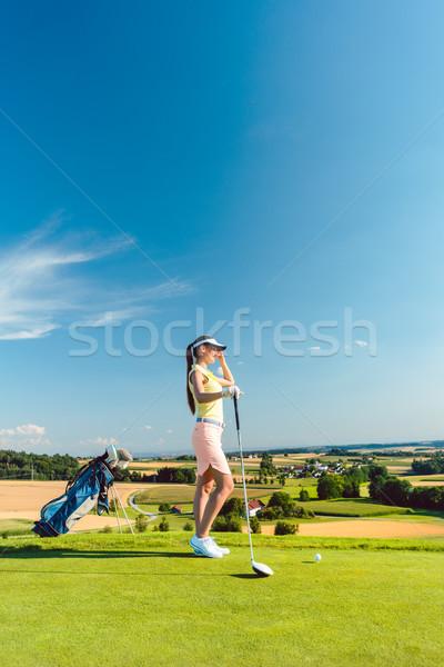 соответствовать женщину глядя горизонте зеленая трава гольф Сток-фото © Kzenon