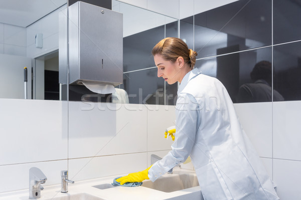 Janitor cleaning sink in public washroom  Stock photo © Kzenon