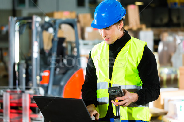 Worker with scanner and laptop at forwarding Stock photo © Kzenon