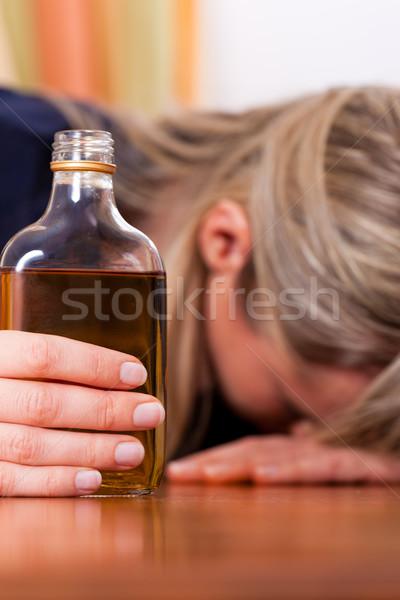 Alkoholu nadużycie kobieta pitnej brandy posiedzenia Zdjęcia stock © Kzenon