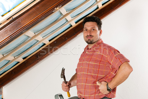 Man doing dry walling, working Stock photo © Kzenon