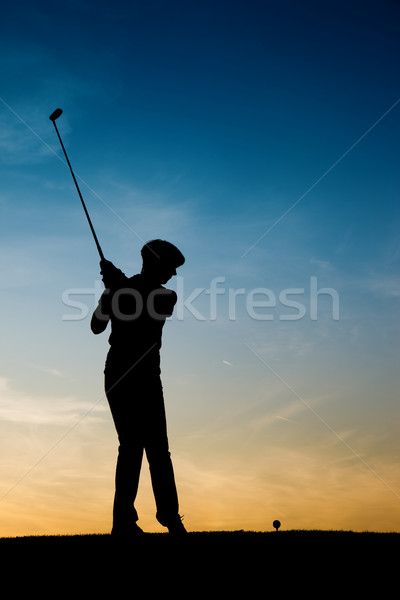 Senior female golf player at sunset Stock photo © Kzenon