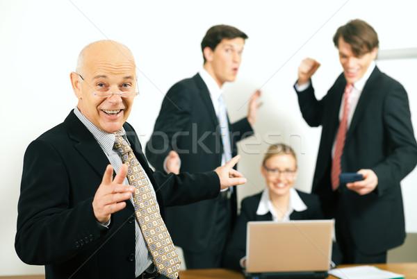 Csoportvezető sikeres üzleti csapat portré előtér szelektív fókusz Stock fotó © Kzenon