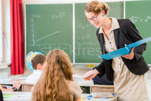 Teacher  teaching a class of  pupils in school Stock photo © Kzenon