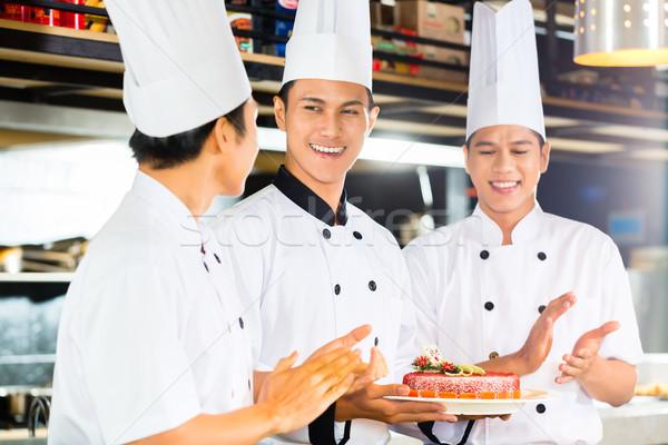 Asian chefs cuisson restaurant portrait jeunes Photo stock © Kzenon