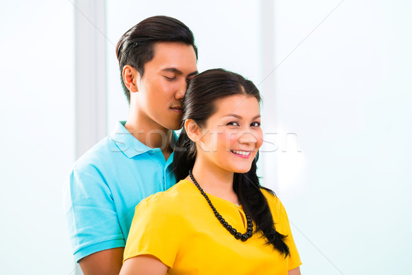 Young Asian couple cuddling together Stock photo © Kzenon