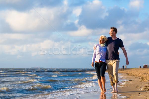 Couple take a walk at German north sea beach Stock photo © Kzenon