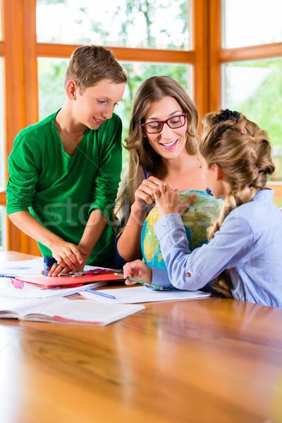 Mother teaching kids private lessons for school Stock photo © Kzenon