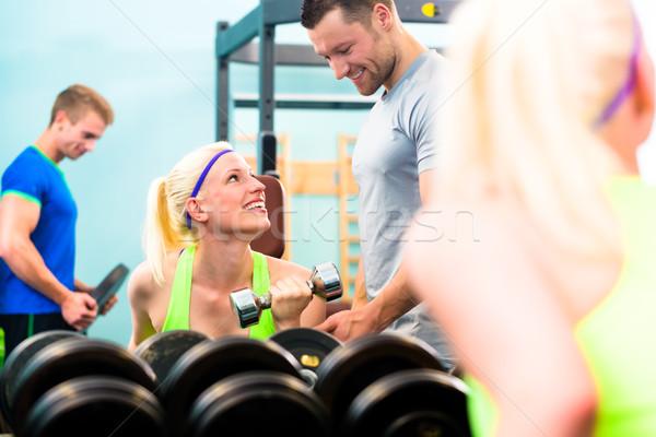 Nő tornaterem képzés néma férfi fitnessz Stock fotó © Kzenon