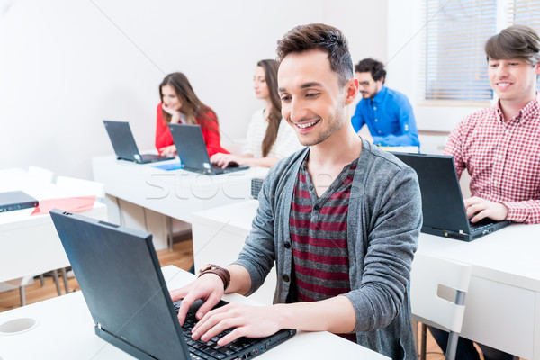Student working on laptop PC in college Stock photo © Kzenon