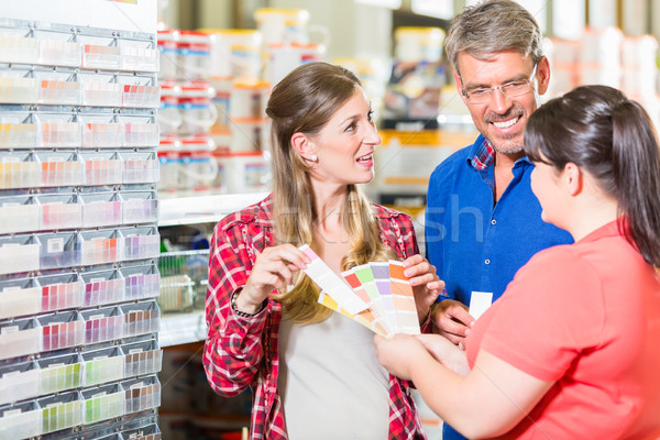 Home improvement store clerk counseling customers about colour Stock photo © Kzenon