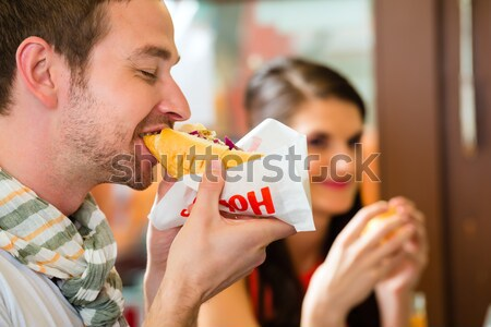 Girls at German Fasching Carnival eating doughnut-like tradition Stock photo © Kzenon
