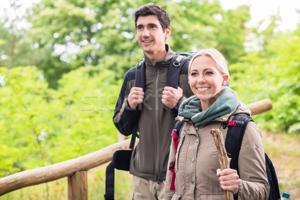Man and woman hiking with rucksack on forest trail  Stock photo © Kzenon