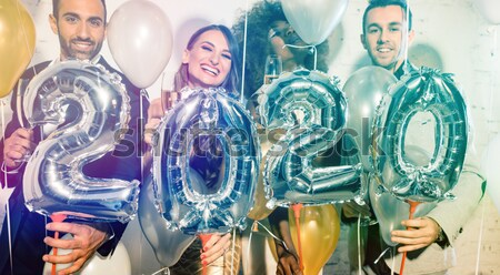 Group of party people celebrating the arrival of 2018 Stock photo © Kzenon