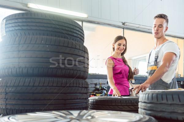 Jóképű autószerelő segít vásárló választ különböző Stock fotó © Kzenon