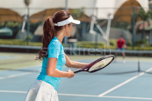 Beautiful and competitive woman smiling before starting the match Stock photo © Kzenon