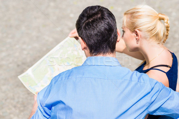 An overhead view of couple looking at map Stock photo © Kzenon