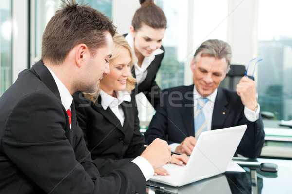 Business people - team meeting in an office Stock photo © Kzenon