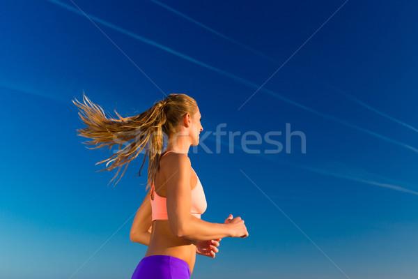 Sport and Fitness - woman jogging  Stock photo © Kzenon