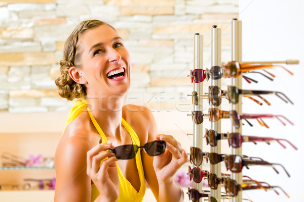 Young woman at optician shopping sunglasses Stock photo © Kzenon