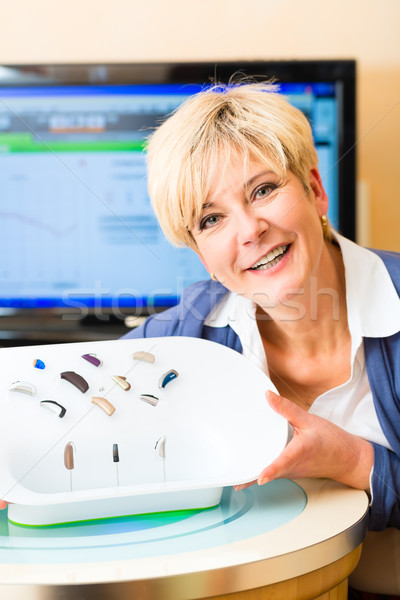 Deaf woman with hearing aids Stock photo © Kzenon