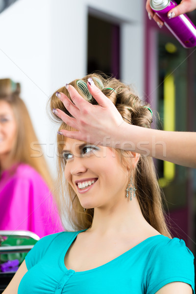 Women at the hairdresser being curled Stock photo © Kzenon