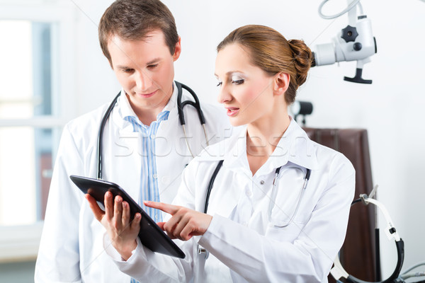 Team of doctors in clinic with tablet computer Stock photo © Kzenon
