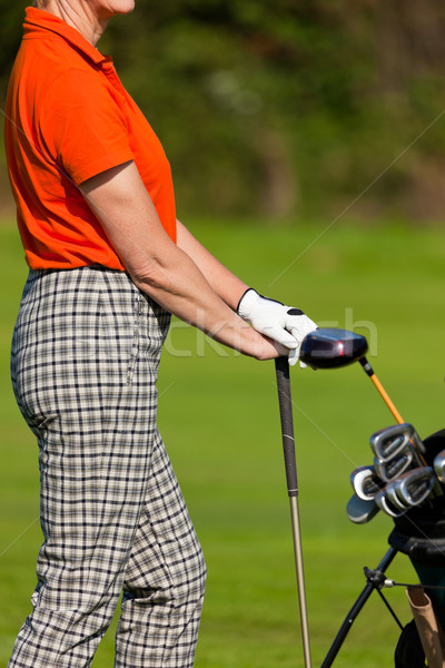 Mature Woman with golf bag playing golf Stock photo © Kzenon