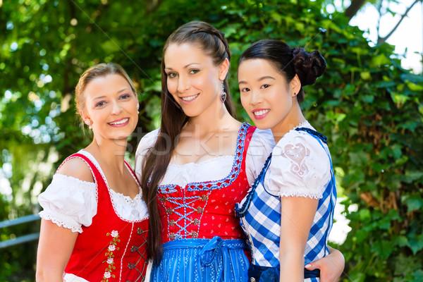 friends in traditional clothes in bavaria Stock photo © Kzenon