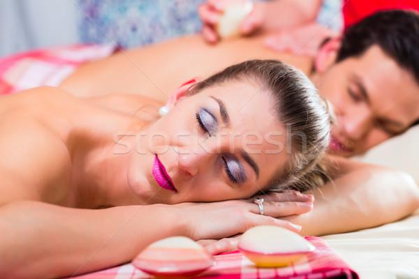 Couple having sea shell massage in wellness spa Stock photo © Kzenon