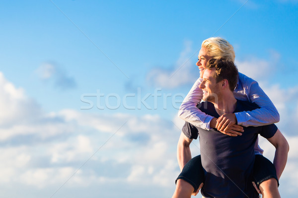 man carrying woman piggyback at beach  Stock photo © Kzenon