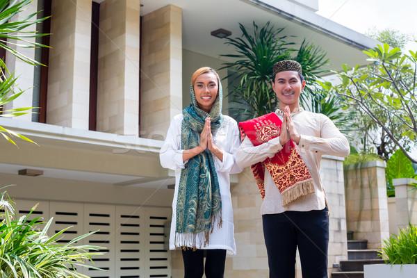 Asian Muslim couple wearing traditional dress Stock photo © Kzenon