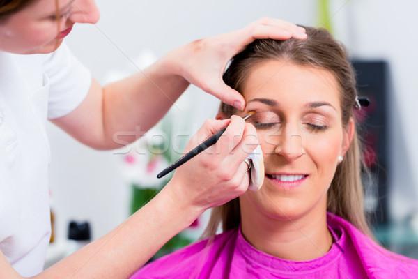 Woman with beautician in cosmetic salon Stock photo © Kzenon