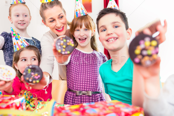 Kids showing muffin cakes at birthday party Stock photo © Kzenon