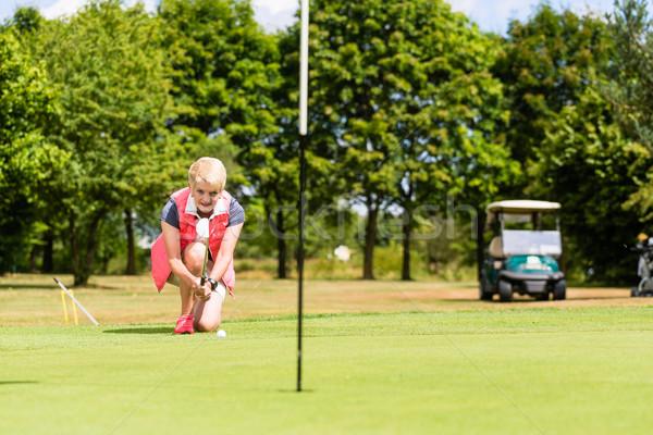 Idős golfozó lyuk nő golf sport Stock fotó © Kzenon