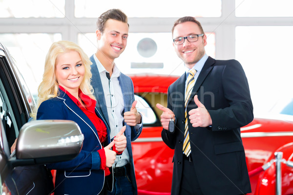 Couple buying new car at auto dealership Stock photo © Kzenon