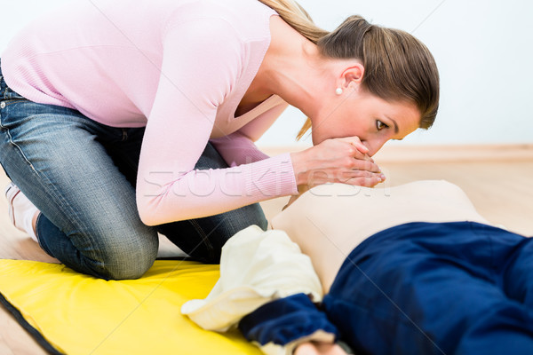 Woman training mouth-to-mouth breath donation on Rescue-Annie  Stock photo © Kzenon